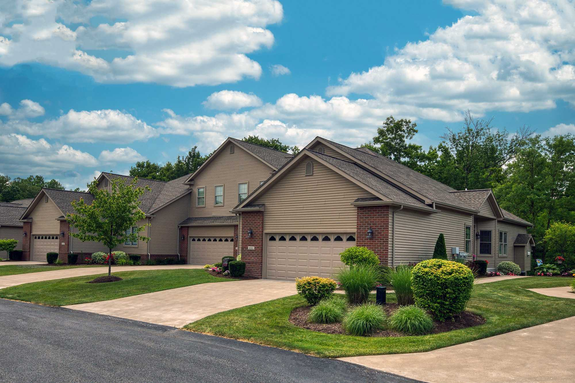 Stonebrook Whispering Woods Erie PA Renaud Peck Triplex Front New Home Build